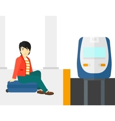 Man sitting on railway platform vector image vector image
