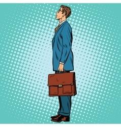 Businessman standing sideways vector image vector image