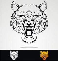 Angry tiger head tribal vector