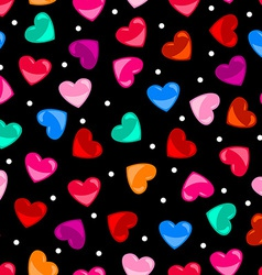 Seamless colorful heart shape pattern over black vector image