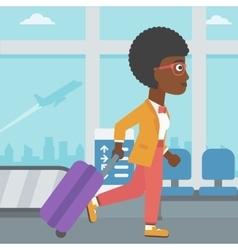 Woman walking with suitcase at the airport vector