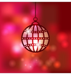 Christmas ball on red blurred background vector image vector image