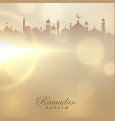 Ramadan kareem card with mosque silhouette vector