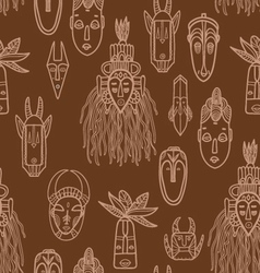 Hand drawn african masks seamless pattern vector