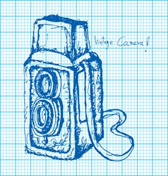Drawing of vintage camera on graph paper vector