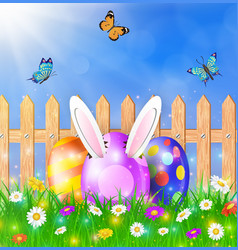 Easter eggs on a grass field with flower vector
