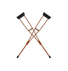 two crossed retro crutches vector image vector image
