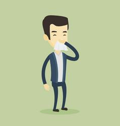 Young asian sick man sneezing vector