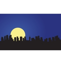 Silhouette of building and full moon vector image