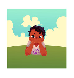 Teenage black african american boy lying on grass vector