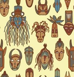 Hand drawn african masks seamless pattern vector