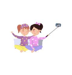 Two girls in pajamas making selfie photo cartoon vector