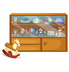 A horse toy beside a wooden cabinet vector