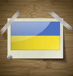 Flags ukraine at frame on wooden texture vector