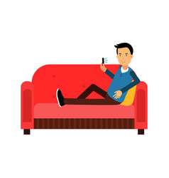 Young man sitting on a sofa using his smartphone vector