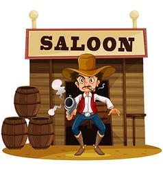 A man holding a gun outside the saloon bar vector image