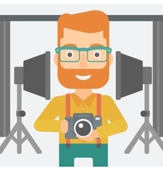 Smiling photographer holding camera vector