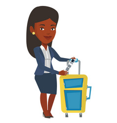 African-american businesswoman showing luggage tag vector