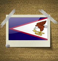 Flags american samoa at frame on a brick vector