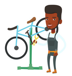 african bicycle mechanic working in repair shop vector image