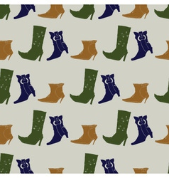 Seamless pattern with colored boots vector