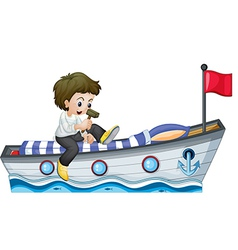 A boy riding in a boat with a red flag vector