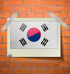 Flags korea south scotch taped to a red brick wall vector