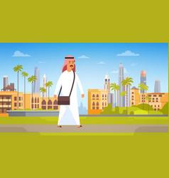 Arab man walking modern city building cityscape vector