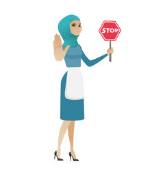 Young muslim cleaner holding stop road sign vector