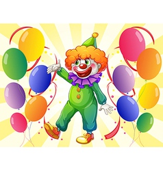 A clown in the middle of the balloons vector