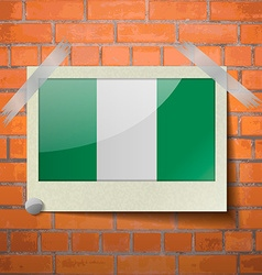 Flags nigeria scotch taped to a red brick wall vector