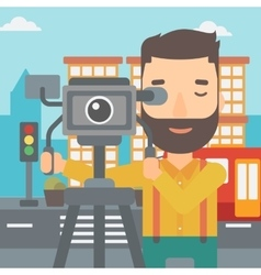 Cameraman with movie camera on a tripod vector