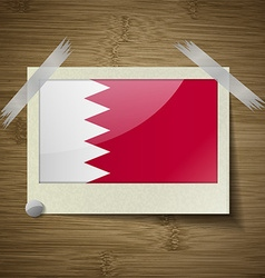 Flags bahrain at frame on wooden texture vector