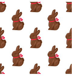 Seamless pattern chocolate bunny with pink ribbon vector