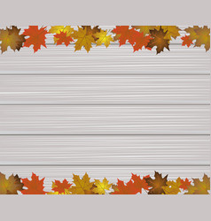 Maple leaves on wooden texture vector