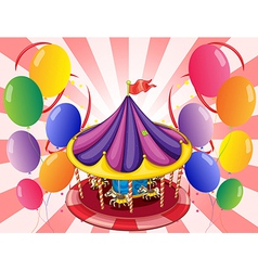 A carousel at the center of the balloons vector