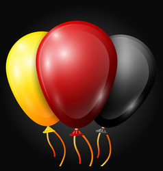 realistic yellow red black balloons with ribbons vector image