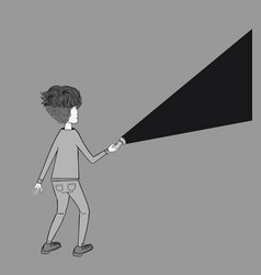 A young man holding a flashlight shines in the dar vector
