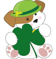 A cute puppy is wearing a green irish hat and is h vector