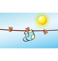 An infant socks hanging with clips vector