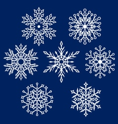 White silhouettes of snowflake vector