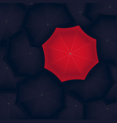 concept of red umbrella standing out of the black vector image