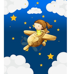 A girl riding in a wooden plane vector image