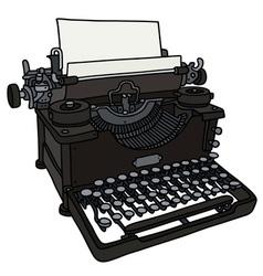 Old black typewriter vector image