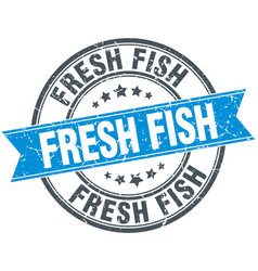 Fresh fish blue round grunge vintage ribbon stamp vector