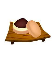 Imagawayaki or red bean pancake on geta plate vector