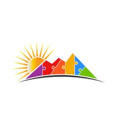 mountain puzzle with sun logo vector image