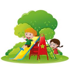 Kids having fun on the slide vector