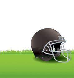 American football helmet sitting in the grass vector