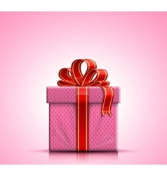 Pink gift box with ribbon and bow vector